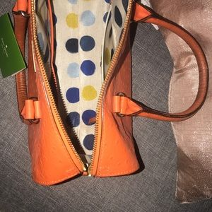 kate spade Bags - Kate Spade Orange Ostrich with Gold trim